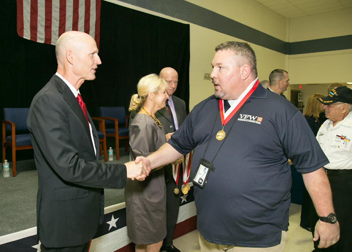Governor Rick Scott greets Thomas Whelan after awarding him the Governor's Veterans Service Award.