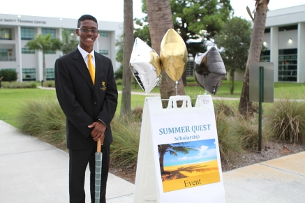 Student ambassador Evander Felix waits to greet Summer Quest participants.