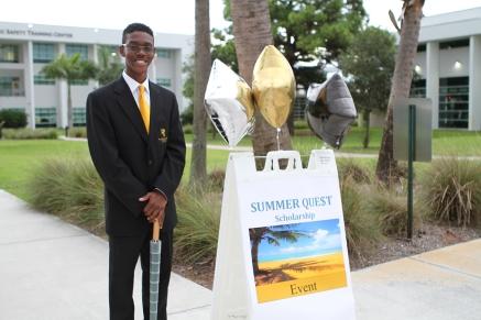 Student ambassador Evander Felix waits to greet Summer Quest participants.
