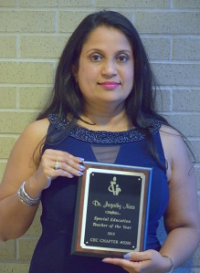Nair with award